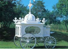 White carriage hearse MC: Probably a child's / infant's hearse, white being reserved for representing purity and innocence.