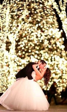 Wedding photo idea. So stunning!! Wow! ❤️ Light up the trees where you want the photo to take place at your wedding reception, then get the photographer to do a long exposure! Done