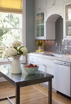 White grey and yellow kitchen, love the backsplash tile. I could see this in Gordie and Michele's kitchen.