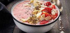 Don't know what to eat for breakfast? Whip up this strawberry smoothie bowl in a matter of minutes and top it with your desired toppings.