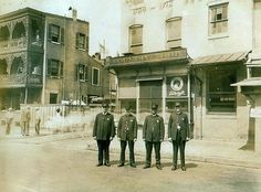Baltimore and Broadway Streets. 1880-1890's, the standing Officers with the badges are Police horse hostlers.  Look closely, they are wearing 5 point stars.  www.baltimorecitypolicehistory.com