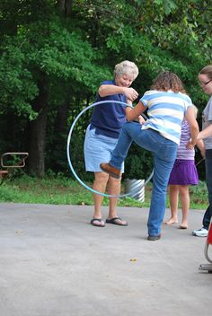 Type of Game: Adult - Hoops  Equipment: Hula Hoops  Formation: Teams  # of Players: 10+    Description: Divide the group into 2 teams and form lines. Each team is given one hoop. On the signal, players of each team have to pass through the hoop and pass it on. The team which does it first are the winners.    If hoops are too easy then use something elastic like a bike tire. Great for a relay.    Variation: You can try this game without using hands-People can become very creative!