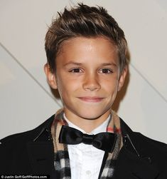 Best of both: The dapper 12-year-old seems to have inherited the best features from both his parents