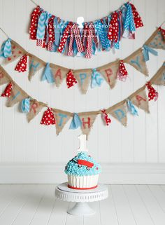 Loved this adorable cake smash. Mom made these super cute banners and it was just perfect with his red wagon themed party and cake! He's changed so much this year!