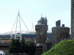 Old and new: Cardiff Castle and Millennium Stadium. Wales, UK