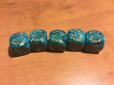 Vortex Teal with Gold pips. $14.99  Makes a great addition to the game or even a souvenir.
