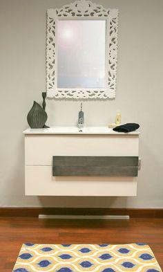Mueble de baño con original diseño. Para darle un toque especial, combina con vinilo decorativo.
