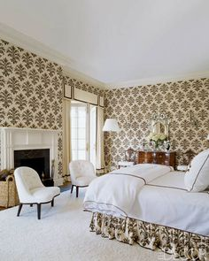 """""""The walls of the master bedroom in East Hampton are covered in a Michael Devine  fabric; the bedding is by Leontine Linens, the tufted chairs  are vintage Edward Wormley,""""  Photography by Simon Upton. """"At Home With Stylesetter Aerin Lauder"""" by Kristina Stewart Ward Elle Decor (July/August 2009).and the rug is from Beauvais Carpets."""