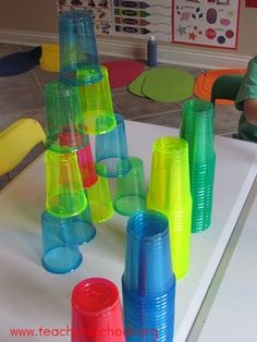 I love the idea of using these colorful cups with a light source, but I was laughing at the stacking for height - that's what my preschoolers typically do!
