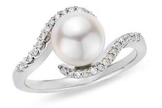 Love the pearl engagement ring