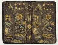 An English embroidered canvas binding, ca. 1630. Canvas over pasteboards, embroidered in colorful silks on a silver gilt background.