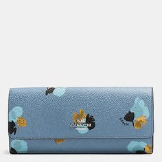 This slim wallet gets an edgy and colorful update with an oversized floral print reminiscent of vintage wallpaper. Crafted in ultra-durable coated canvas, it has a well-appointed interior, complete with card slots, full-length billfold compartments and a zip coin pocket.