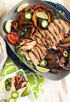 The BEST chicken fajitas ever!  Made entirely on the grill for a mess free dinner, perfect for tailgating.