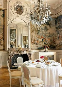 European Manor dining room, crystal chandelier, panoramic mural, French white ornamental architectural detail
