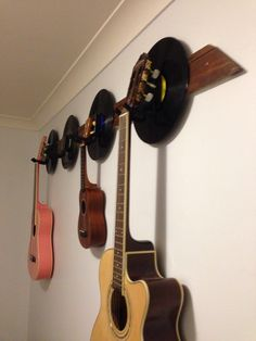Old vinyl records used for backing of guitar wall hooks - nailed it! Guitar Wall Hooks, Old Vinyl Records, Wine Rack, Storage, Furniture, Home Decor, Purse Storage, Homemade Home Decor, Larger