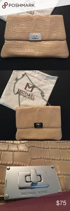 MICHAEL KORS beige w/ silver hardware giant clutch This gorgeous beige clutch with silver hardware is perfect day and night. Can be worn as a clutch, on the shoulder and cross body as the chain may or may not be used. Plenty of space inside! Perfect condition Michael Kors Bags Clutches & Wristlets