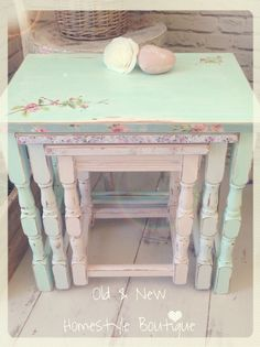 A beautiful nest of tables painted in pastel mint, blue & pink chalk paint & decoupaged with flowers
