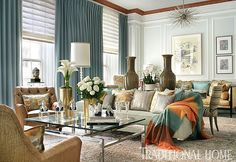 Against pale blue walls,  soft-pleated Roman shades team with ceiling-to-floor draperies in aqua blue. - Traditional Home ®/ Photo: Peter Rymwid / Design: James Rixner