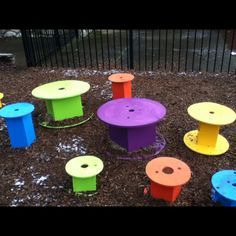 DIY playground stepping stools: use various sizes of wooden spools, replace cardboard centers w/ wooden ones, paint, place & secure.  Our preschoolers love them!