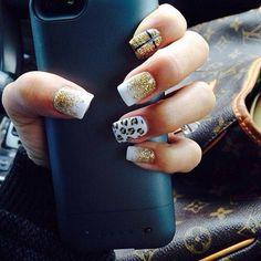Gold and white + leopard nails. No thank you on the cross, though. Lol