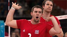 Justin Phillips of Great Britain celebrates as the team scores a point against Russia in the first match of the men's Sitting Volleyball competition.