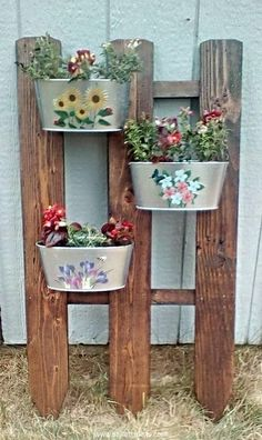 A vertical garden would give you all the freedom to use it to serve some multiple purposes. This can be used to plant mere plants, plus this can also be used as a decent garden décor idea or wherever you place this wooden installation. Here we used some cute metallic flower buckets hanging on the wood pallet planter.