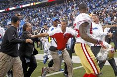In this photo, San Francisco 49ers head coach Jim Harbaugh, left, and Detroit Lions head coach Jim Schwartz, right, shout at each other after a game in Detroit. Harbaugh enraged Schwartz with a firm backslap and handshake, and the two had to be separated. Schwartz returns to Detroit Sunday as Eagles defensive coordinator.