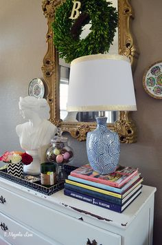 Colorful and eclectic front entryway with touches of spring; plus lots of layering and pattern mixing for visual interest.