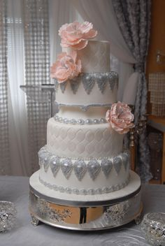 Gilded silver accents compliment this uniquely styled wedding cake.  Old world meets new!
