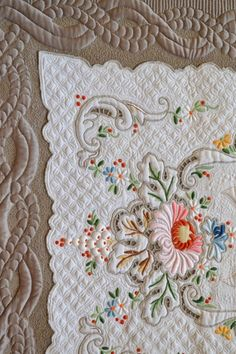 Linen embroidered quilt by Kathleen Rountree, featured at Cindy Needham Quilts. Made with a beautiful Madeira linen table runner.