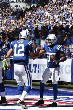 Andrew Luck and Reggie Wayne - My two favorites!! I'll take Luck as our QB over ole twinkle toes Manning anyway!