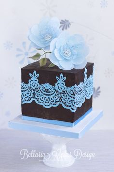 small black and light blue wedding cake