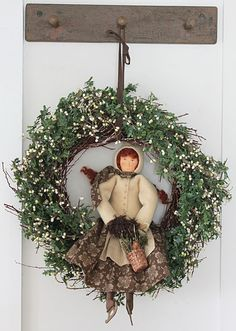 Handmade doll in a wreath! Reminds me of the dolls we made out of yarn when we were kids.
