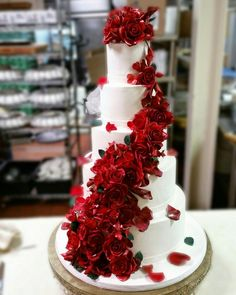 Red roses wedding cake.  All flowers are created in sugar.  Cake by www. mydaughterscakes.com My Daughter's Cakes