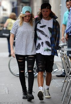 Keeping close: Ellie Goulding and boyfriend Dougie Poynter were spotted out and about in London on Saturday