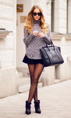 I like the combination of the flirty short skirt and hose, which shows off her legs and the sweater that is a little loose so she is highlighting a specific area she wants to show off.