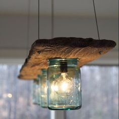 Reclaimed wood and vintage mason jars combined for a beautiful upcycled light fixture!