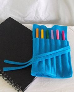 Felt Pencil Case:  How to sew a simple roll-up case for pencils or markers.