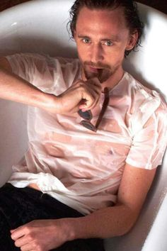 Tom Hiddleston. Yet again, far too sexy for his shirt.