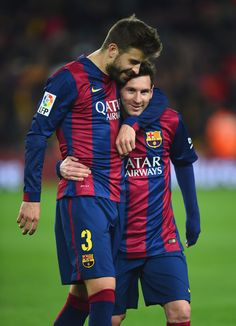 Gerard Pique and Lionel Messi of Barcelona celebrate victory after the La Liga match between FC Barcelona and Real Madrid CF at Camp Nou on March 22, 2015 in Barcelona, Catalonia.