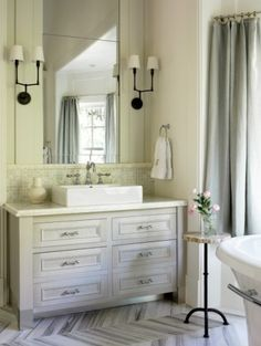 """I like the color and style of the vanity, and the glazed tile backsplash.  Vanity color: Liz Williams Interiors """"The cabinets were painted by a decorative painter, so there were several layers and steps. I believe we started with Ben/ Moore 'Moonshine.'"""""""