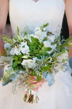 Wild green & white bouquet featuring Succulents, Veronica, Dusty Miller, fresh Mint, white Stock, Freesia, Lisianthus, and unripe berries!