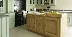 Fired Earth Bastide Fitted Kitchen Furniture in Light Oak and Weald Green with 3-Oven Pewter AGA