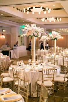 Glam wedding centerpiece - tall, gold centerpiece with pink + white arrangement {Altar Ego Weddings}