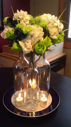 Centerpieces idea, wine bottles, would probably fill the bottle with something though...
