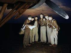 A combat crew receives final instructions just before taking off in a mighty B-17 bomber from a bombardment squadron base at the field, in Langley Field, Virginia, in May of 1942.