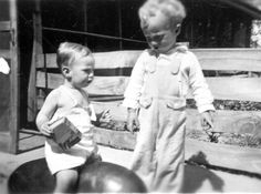 1937  Ray and Dean Young on watermelon grown on the home place. Best I can remember it was 65#. I'm the one on the melon so you know I remember. Ray