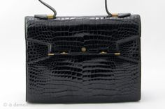 1980s Pierre Cardin Crocodile Porosus Handbag | From a collection of rare vintage handbags and purses at http://www.1stdibs.com/fashion/accessories/handbags-purses/