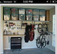 Save space. Hang the bikes and store the clutter in totes up on a shelf. Learn more tips in this DIY garage makeover article http://www.lender411.com/featured-article-diy-budget-garage-redoing-your-garage-on-the-cheap/