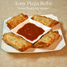 Easy Pizza Rolls are made with mozzarella cheese and pepperoni in a egg roll wrapper deep fried and served with pizza sauce.